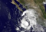 Satellite sees Tropical Storm Simon crawling up Western Mexicos coastline